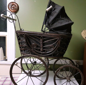 Antique doll carriage with porcline handles