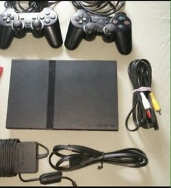 PlayStation 2 ps2 with 2 original pads all wires no games good condition