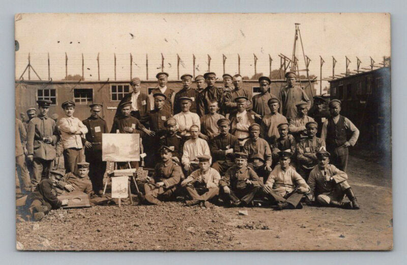 Antique WW1 GERMAN Real Photo RPPC Postcard POW CAMP with ART CLASS Soldier Band
