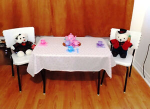CHILD'S WHITE TABLE AND CHAIRS