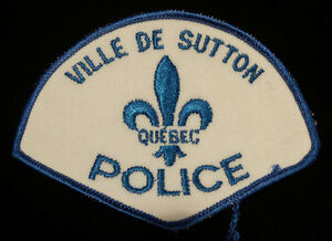 écusson de police bnq / badge / Sutton ville de