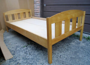 Used Solid Wood Single Bed with2 boards to support mattress($20)