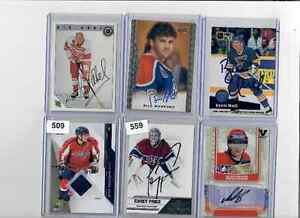 Various signed sport cards.