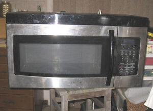 Slightly used Samsung Stainless Steel Over The Range Microwave i