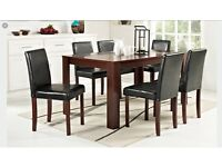 Dark wood dining room table and 6 chairs