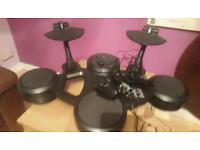 Electronic drum machine with headphones socket.