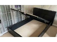 New leather double bed with hydraulic access...
