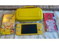 Nintendo Switch Lite with 2 games and matching carry case