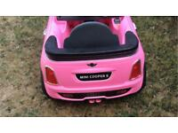 Child's pink mini electric ride on car