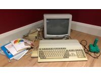 Commodore Amiga 500 Computer with monitor, joystick, mouse, manuals and power supply included.