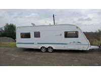 2005 Swift Conqueror 650 LUX - 6 Berth twin axle with full awning caravan