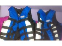 Two adult life jackets / water ski jackets