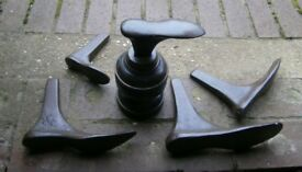 Set of 5 cast iron shoe lasts with nice wooden stand