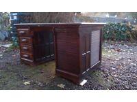 Vintage twin pedestal roll front desk