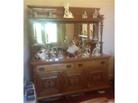 1870s Art Noveau mirror backed side board with cellerette. Solid oak very good condition.