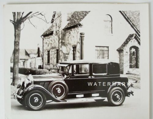 Auburn 8-125 Four Door Sport Sedan parked in front of house: Original 1930 Photo