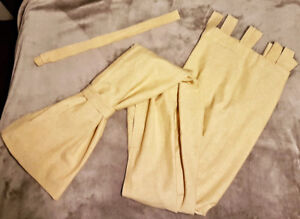 Mustard curtains with tie backs. 4 panels