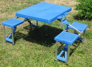 Portable folding camp/picnic table with seats