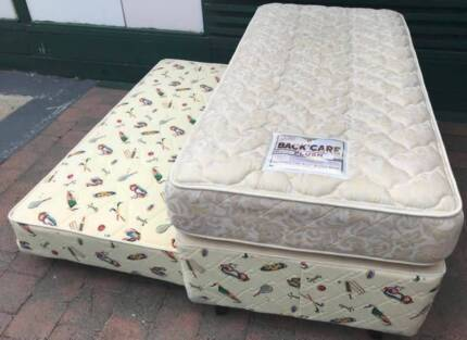 Excellent condition crownposture single trundle bed set for sale.
