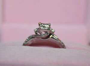 1/4 Carat Quad set Princess cut Diamond ring.