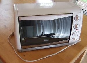 Oster Toaster Oven - Works and clean. Not being used.