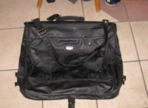 Lightly used Travel Garment Bag that folds to become a suitcase