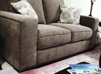 OVER-SIZED sofa and loveseat with nail-head accents in neutral s