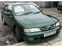 Nissan Primera with leather seats and a/c