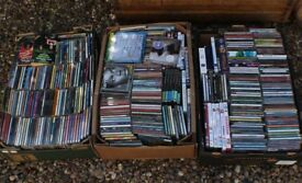 3 Boxes of CD includes some DVD's and Books