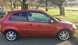 ford fiesta 1.4 TDCI tango red 3drs 57 plate