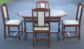 Solid oak dining table and four chairs draw leaf extending.