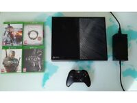 Xbox one console and 4 games