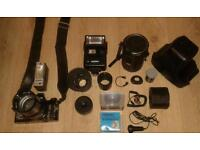 Camera with extra lenses and flash and other bits complete in bag