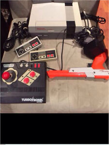 NES SYSTEM WITH MARIO/duck hunt game - gun -2 controllers