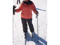 Black ski pants and orange bench ski jacket ladies