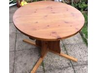 Round solid wooden oak table