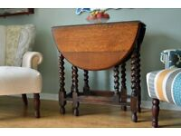 Beautiful Oak Gate Leg Table with Barley Twist Legs believed to be from the 1930's.