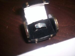 sterling silver and diamond band ring ,stamped 925 set with 31
