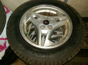 195/65R15 SNOW TIRES AND RIMS OFF A PONTIAC SUNFIRE