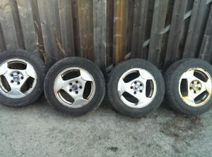 4 Saab 15'' Wheels with 195-65-15 Goodyear Eagle GT Tires.