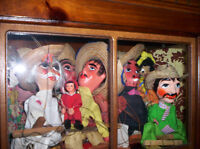 marionettes and puppets and an octoberfest hat and pins