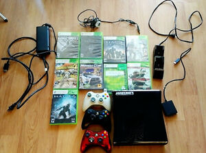 XBOX 360 with 9 games, 3 controllers, charging doc and chords