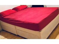 Bed with a mattress and 2 drawers
