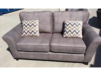 Brown 2 seater fabric sofa (New ex display)
