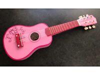 Small kids pink ukulele