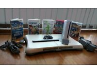 Nintendo Wii Console with two remote controls two Nunchuks, one motion + adapter Wii Fit balance Brd