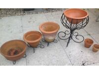 6 Terracotta Plant Pots with 4 Black Iron Stands