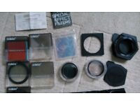 Collection of Various 49mm Filters with Universal Holder and Adaptor Ring