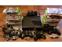 Xbox 360 slim with 32 games.