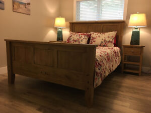 reclaimed wood queen sized bed with mattress and side tables
